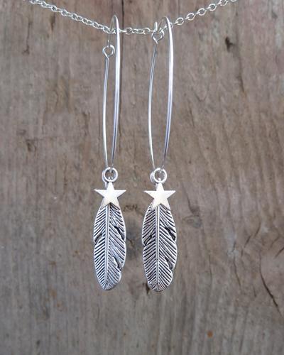 Door Roos oorbellen feather en star zilver